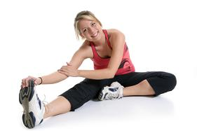 A woman stretching and getting ready to exercise.